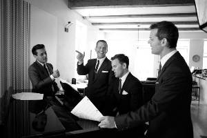 men singing at piano